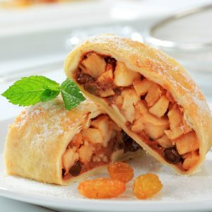 Two pieces of apple strudel decorated, serve on a plate
