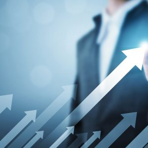 Business development to success and growing growth concept. Businessman pointing arrow graph corporate future growth